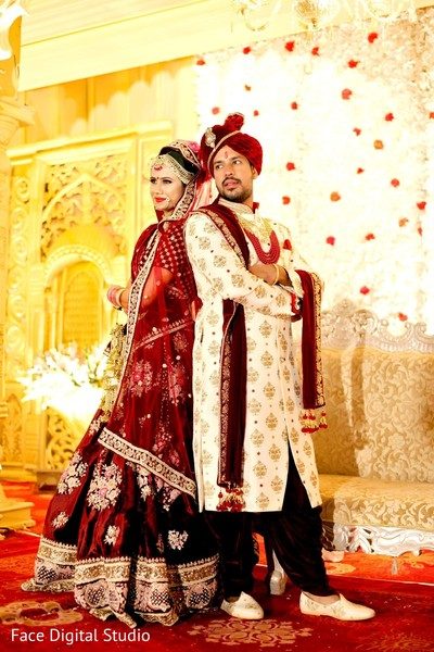 Bride and groom posing for the photoshoot.