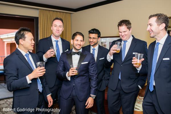 Elegant indian groom celebrating with his groomsman