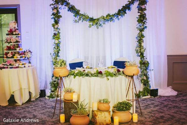 Delightful Indian couple's reception table decor.