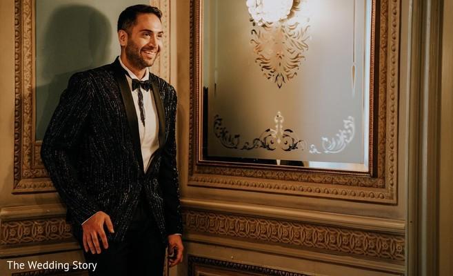 Elegant Indian groom on his reception fashion.
