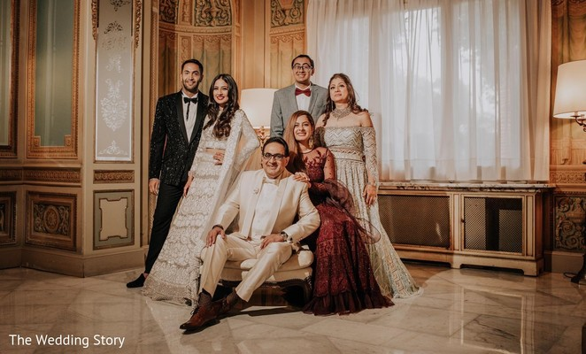 Heartwarming Indian bride and groom with relatives photography.