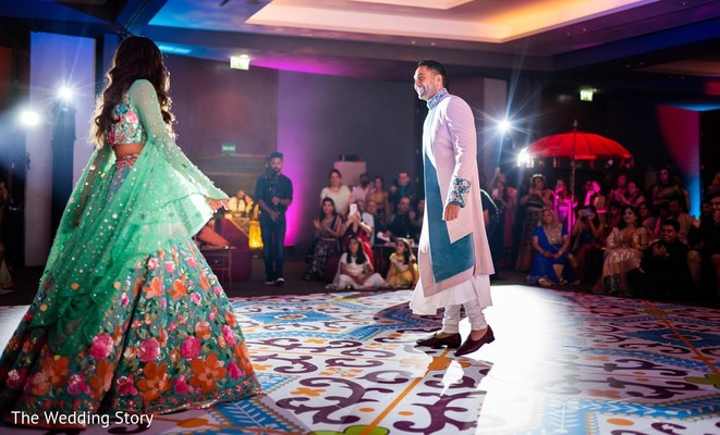 Cheerful Indian couple at sangeet dance.