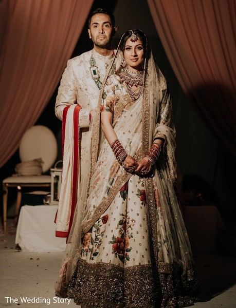 Elegant Indian couple on their wedding ceremony outfit.