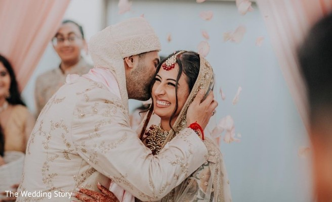 Joyful Indian couple at their wedding ceremony.
