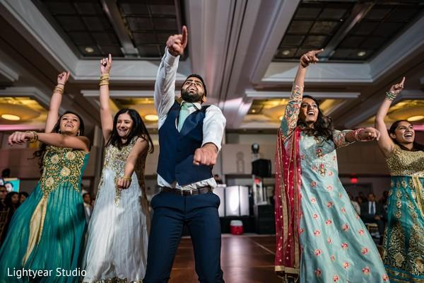 Joyful bridesmaids and groomsmen performance