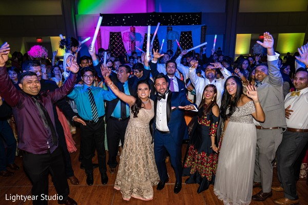 Indian bride and groom capture with guests