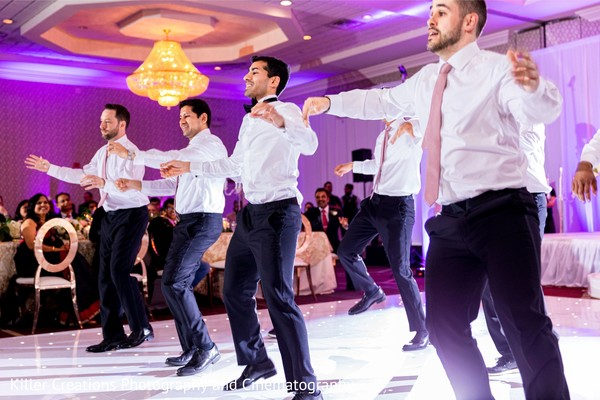 Indian groom and groomsmen during reception choreography.