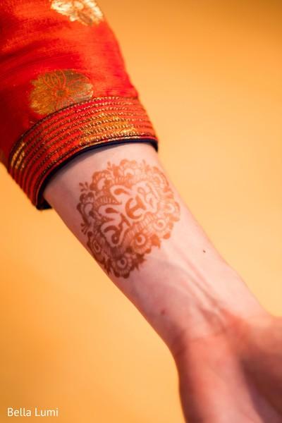 Cute groom showing his henna art