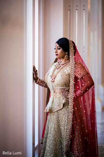 Adorable indian bride looking out the window