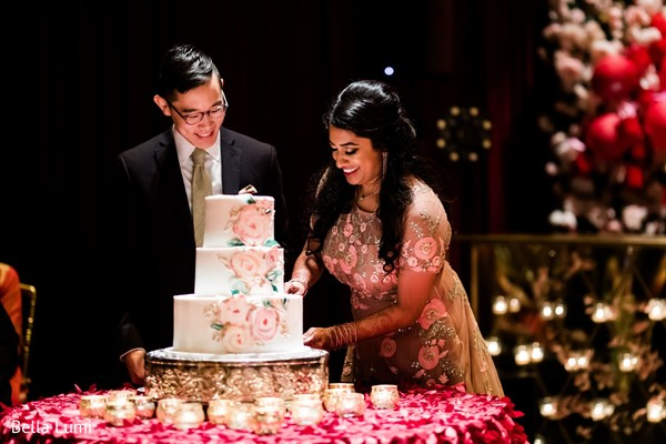 Lovely capture Indian bride and groom cutting cake together
