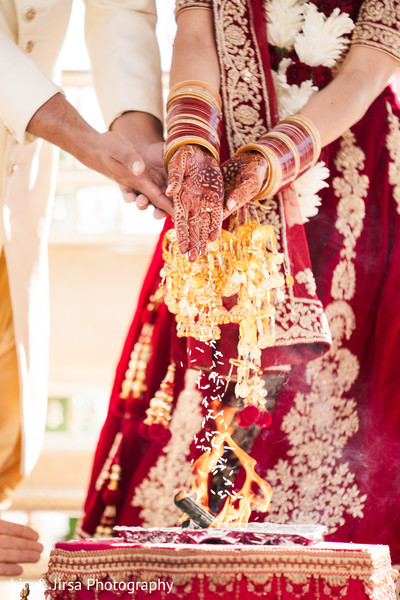 Indian bride and groom during the holy fire rituals.