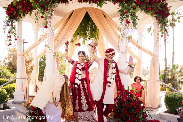Indian bride and groom under the mandap.