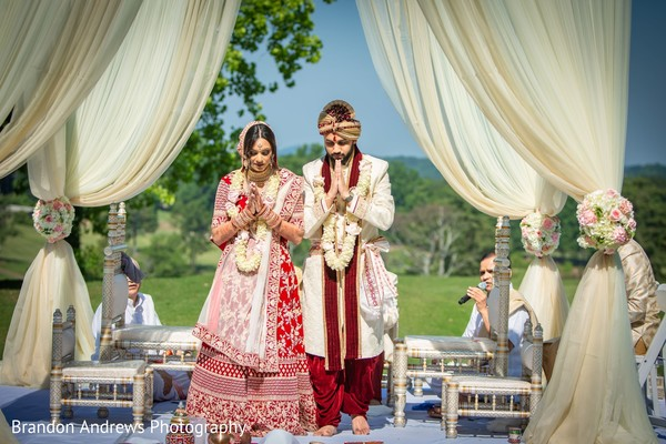 Indian couple praying at their wedding.