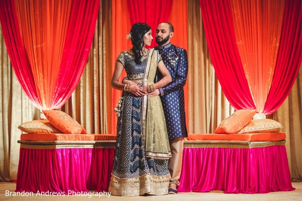 Loving Indian couple with a beautiful mandap.