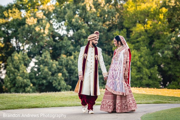 Stunning Indian couple holding hands.