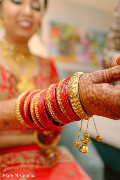 Incredible Indian bridal's golden and red bangles