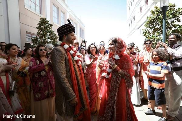 Lovely indian bride receiving groom from baraat