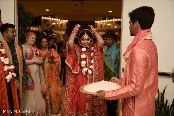 Indian bride's grand entrance to wedding ceremony