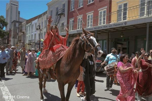 Joyful indian bride riding a horse