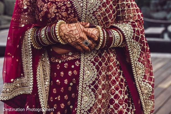 Impressive Indian bridal ceremony lehenga and mehndi art.