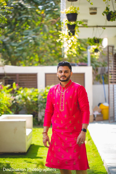 Indian groom wearing the sherwani.
