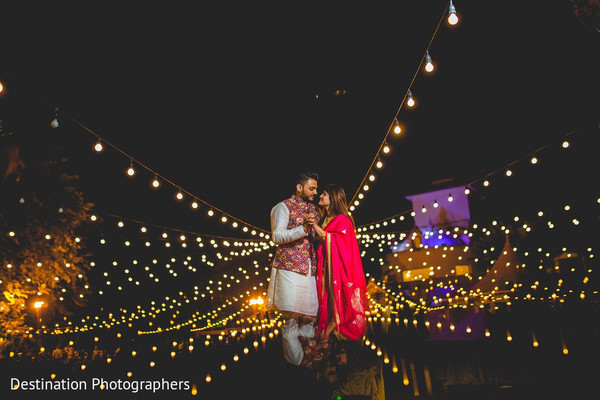 Indian groom and bride having a romantic moment.