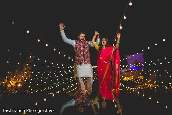 Indian groom holding hands.