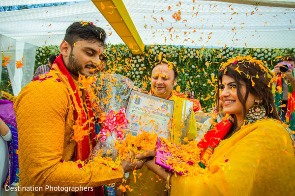 Indian bride and groom at haldi rituals.