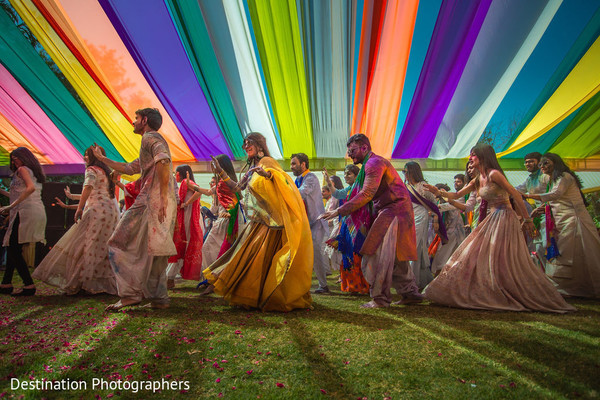 Upbeat Indian bride and groom dancing capture.