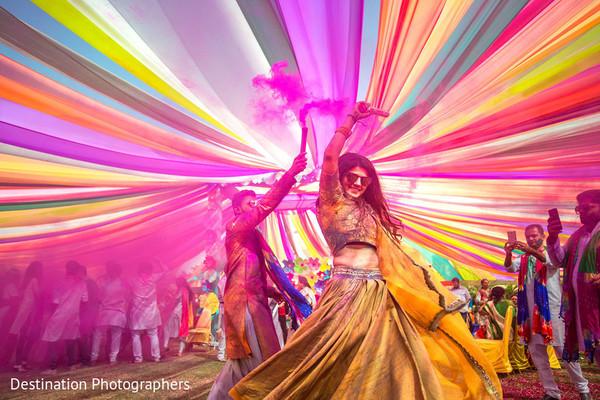 Maharani and rajah dancing at haldi celebration.