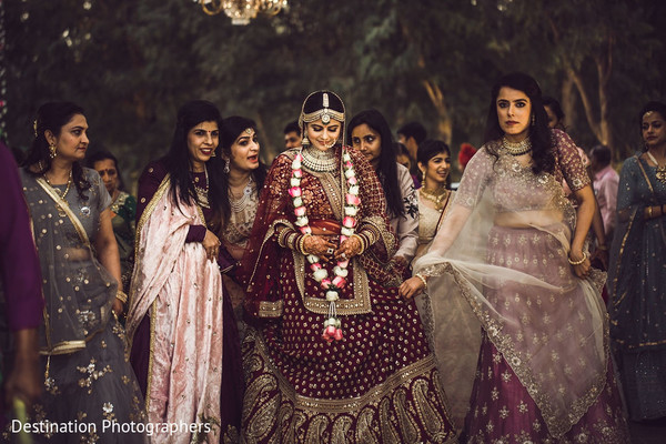Enchanting Indian bride with bridesmaids capture.