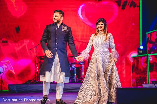 Joyful Indian couple at their wedding reception.