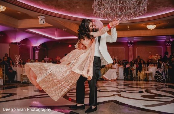 Indian bride and groom having a dance.