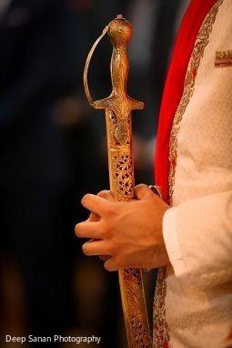 Raja holding the kirpan.