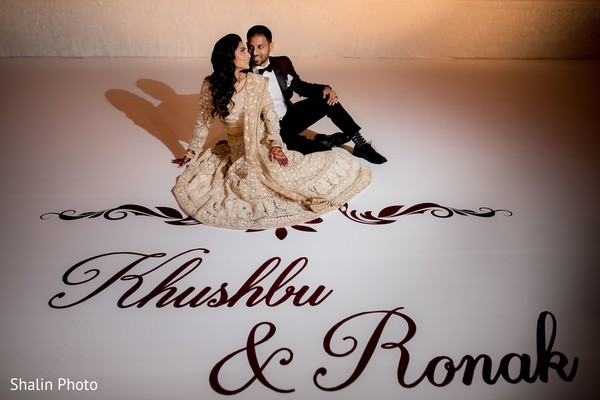 Marvelous Indian couple posing on their personalized dance floor.
