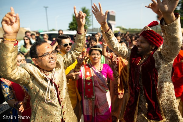 Joyful indian grooms showing some dance moves.