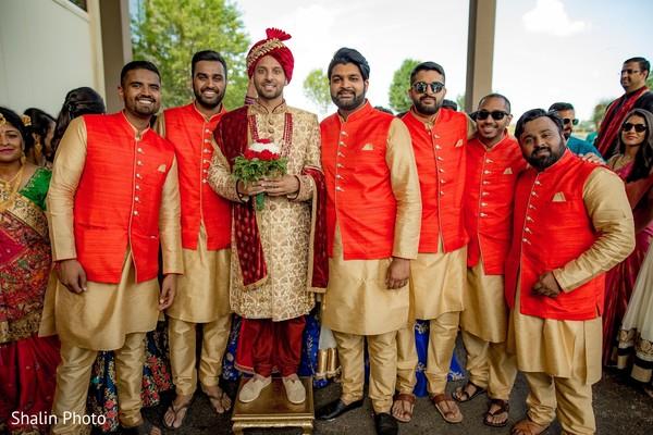 Joyful indian groomsmen with grooms capture.