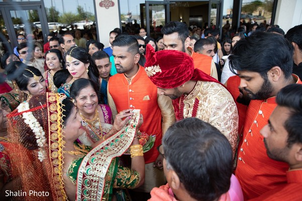 Traditional Indian grooms milni capture.