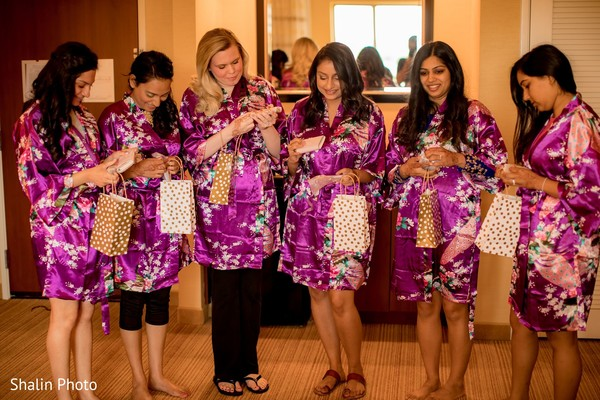 Lovely Indian bridesmaids getting their gifts.