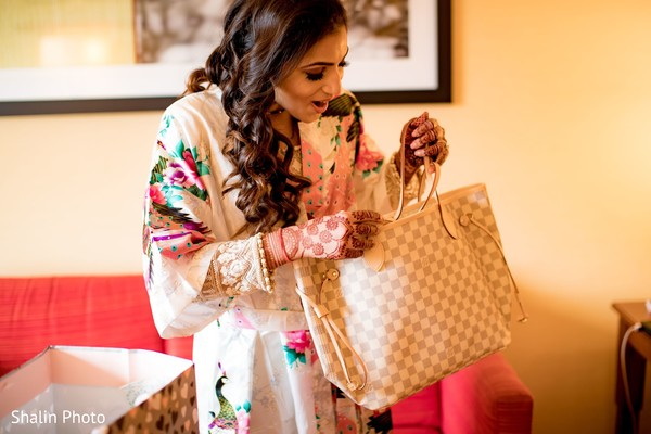 Marvelous Indian bride with her gift.