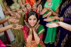 Marvelous Indian bridal with bridesmaids with mehndi art.