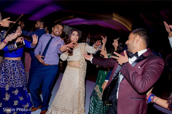 Indian Couple dancing at reception party.