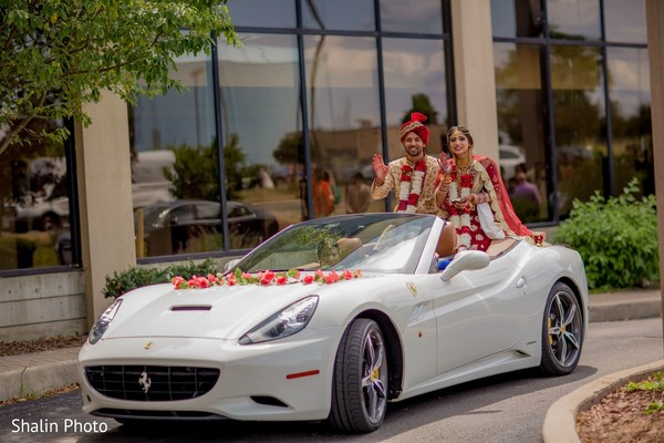 Indian couple at their wedding vehicle.
