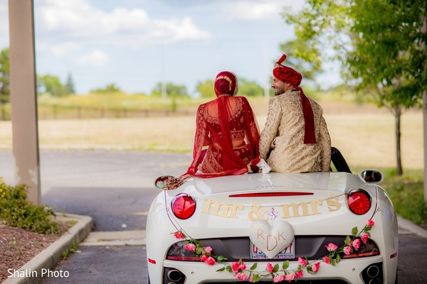 Joyful Indian bride and groom capture.