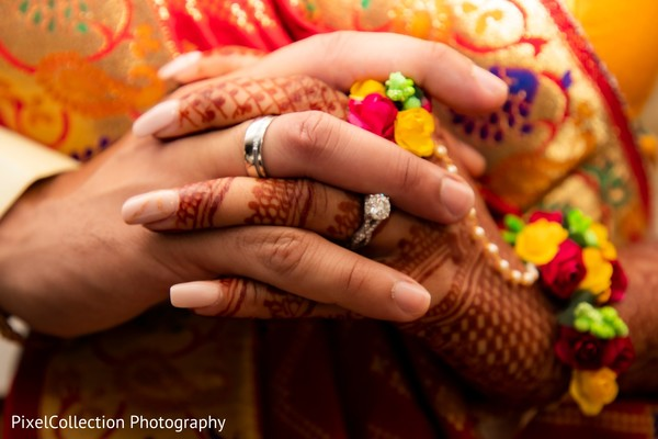 Cute indian bride and groom holding hands