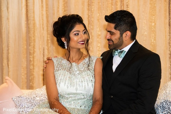 Indian bride and groom wedding reception outfit