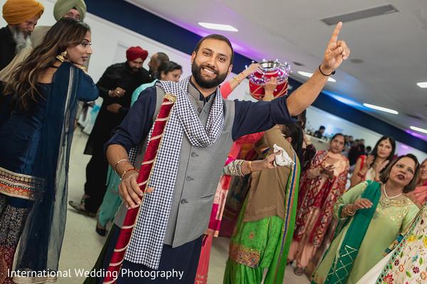Indian groom enjoying the sangeet.