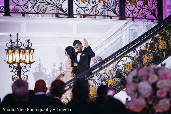 Indian newlyweds making their entrance to wedding reception.