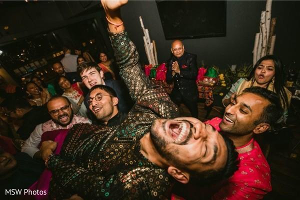 Jubilant Indian pre-wedding celebration.