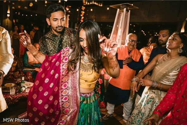Lovely Indian couple dancing at sangeet.